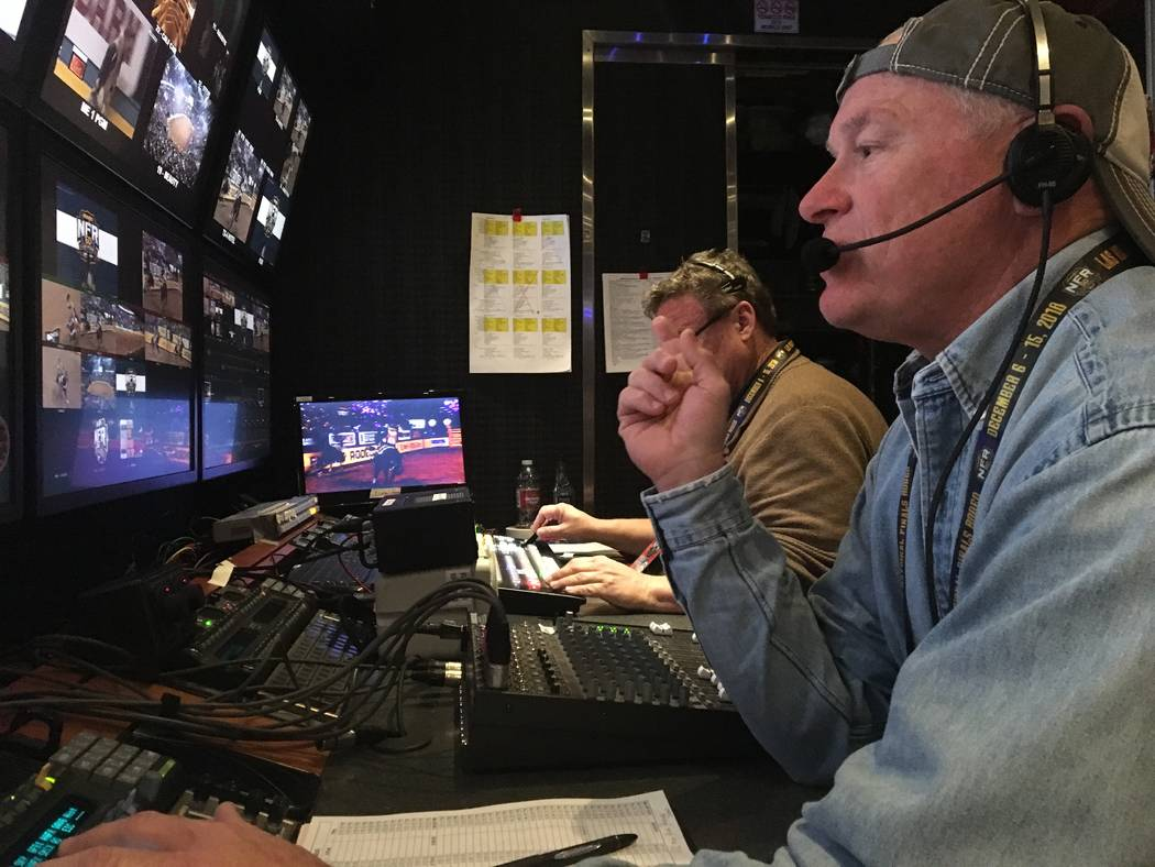 Rick Davidson, who directs the Wrangler NFR's live satellite feed from a production trailer outside the Thomas & Mack Center, guides his camera crew through a series of shots during Tuesday night' ...