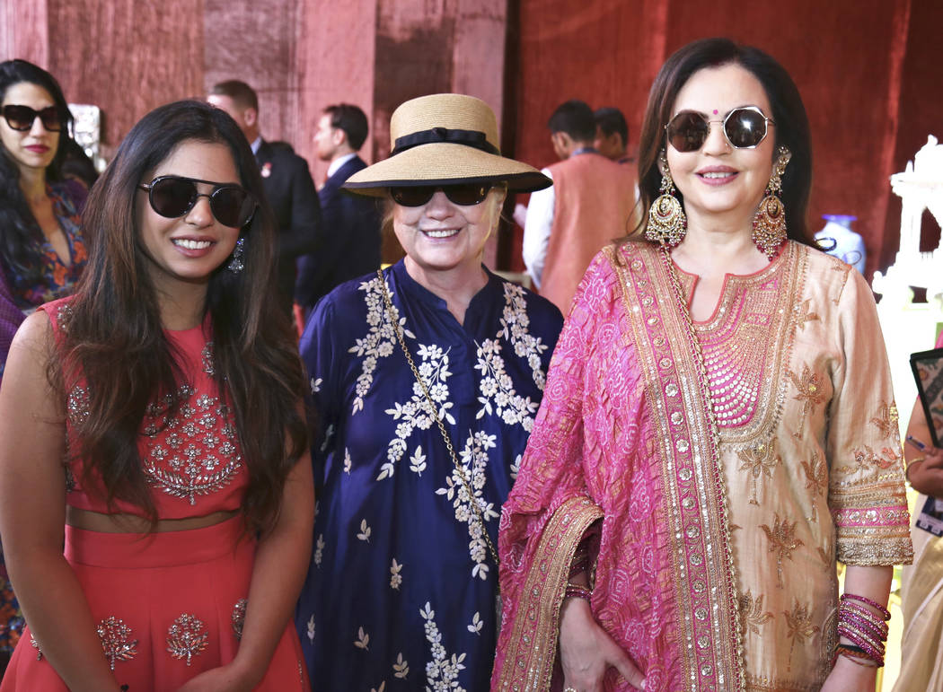 In this Sunday, Dec. 9, 2018 handout photo released by Reliance Industries Limited, Hillary Clinton stands and Nita Ambani, right, visit a curated showcase of traditional Indian crafts and art for ...