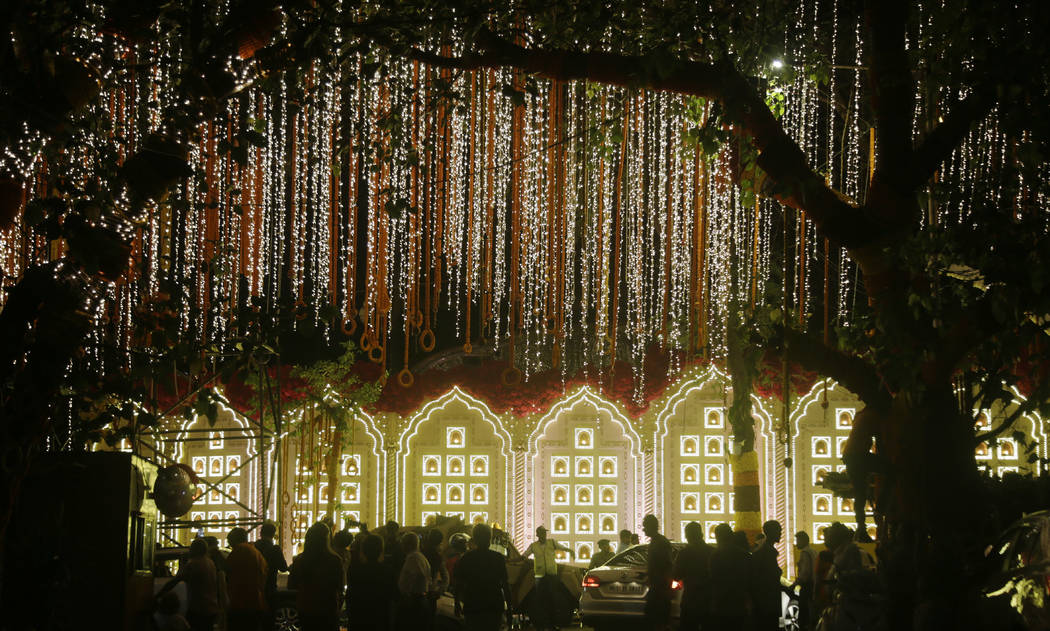 A street is lit-up outside the house of Reliance Industries Chairman Mukesh Ambani ahead of the wedding of his daughter Isha in Mumbai, India, Tuesday, Dec. 11, 2018. Isha Ambani, the daughter of ...