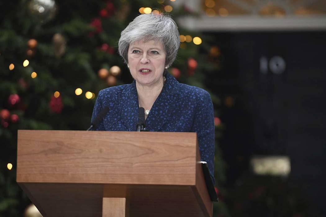 Britain's Prime Minister Theresa May makes a media statement in Downing Street, London, confirming there will be a vote of confidence in her leadership of the Conservative Party, Wednesday Dec. 12 ...