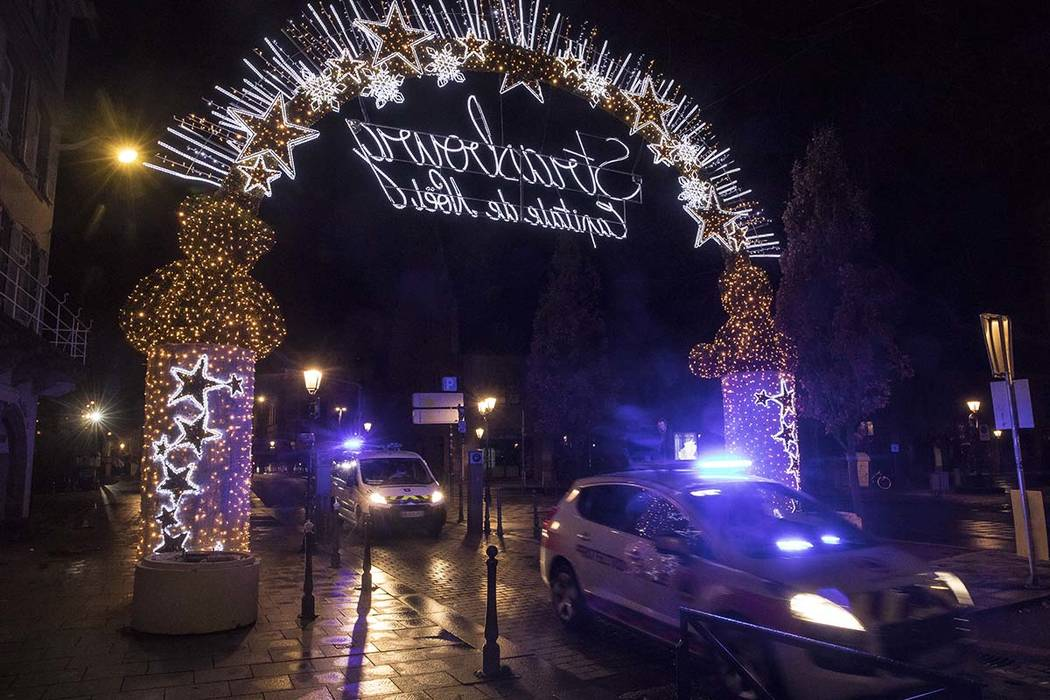 Police vehicles move at the center of the city of Strasbourg following a shooting, eastern France, Tuesday Dec. 11, 2018. A man who had been flagged as a possible extremist sprayed gunfire near th ...