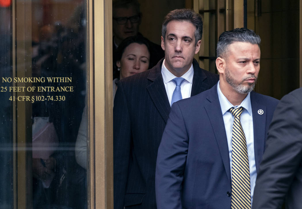 Michael Cohen, President Donald Trump's former lawyer, leaves federal court after his sentencing in New York, Wednesday, Dec. 12, 2018. Cohen was sentenced Wednesday to three years in prison for a ...