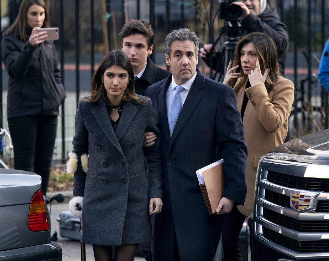 Michael Cohen, second from right, President Donald Trump's former lawyer, accompanied by his children from left, Samantha and Jake, and his wife, Laura Shusterman, right, arrive at federal court f ...