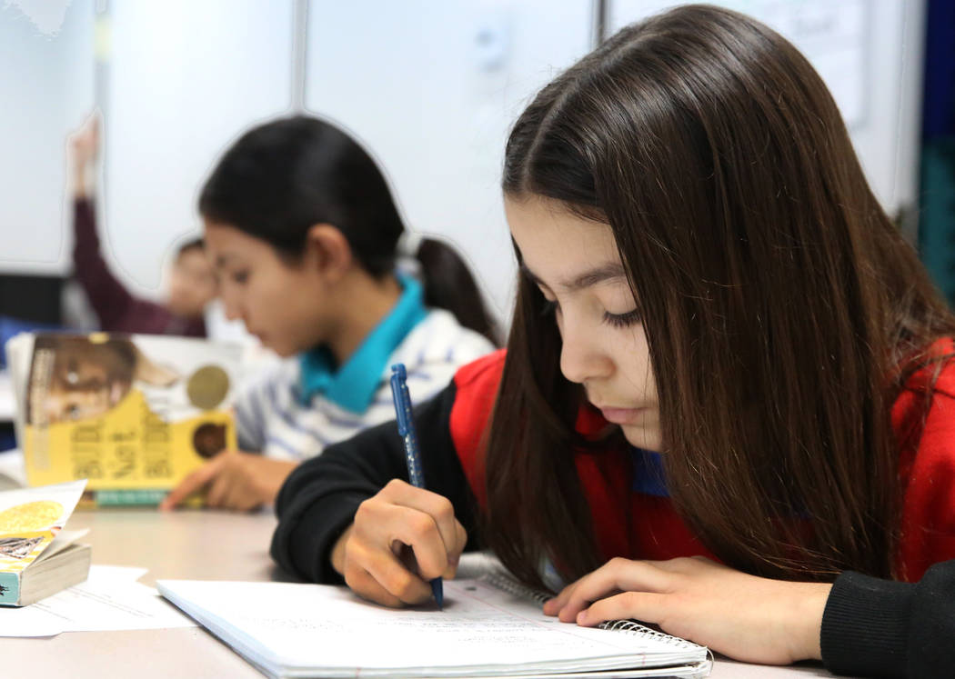 Six grade student Nicole Stanhope writes during English class at Nevada Rise Academy on Tuesday, Dec. 11, 2018, in Las Vegas. Bizuayehu Tesfaye Las Vegas Review-Journal @bizutesfaye