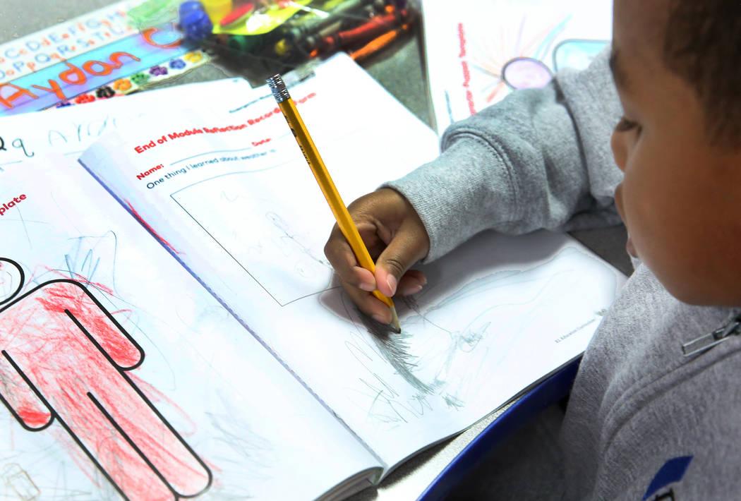 Kindergarten student Aydan Clare colors at Nevada Rise Academy on Tuesday, Dec. 11, 2018, in Las Vegas. Bizuayehu Tesfaye Las Vegas Review-Journal @bizutesfaye