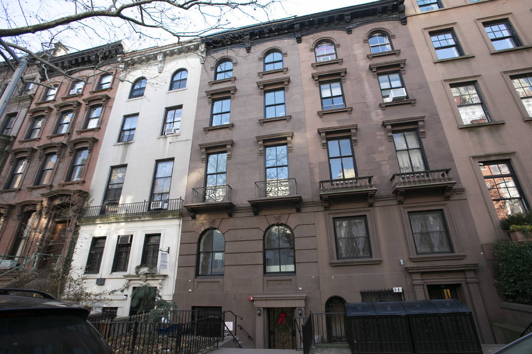 A brownstone apartment building, center, owned by Kushner Companies is shown in the Brooklyn Heights neighborhood of New York, Dec. 10, 2018. An Associated Press investigation found President Dona ...