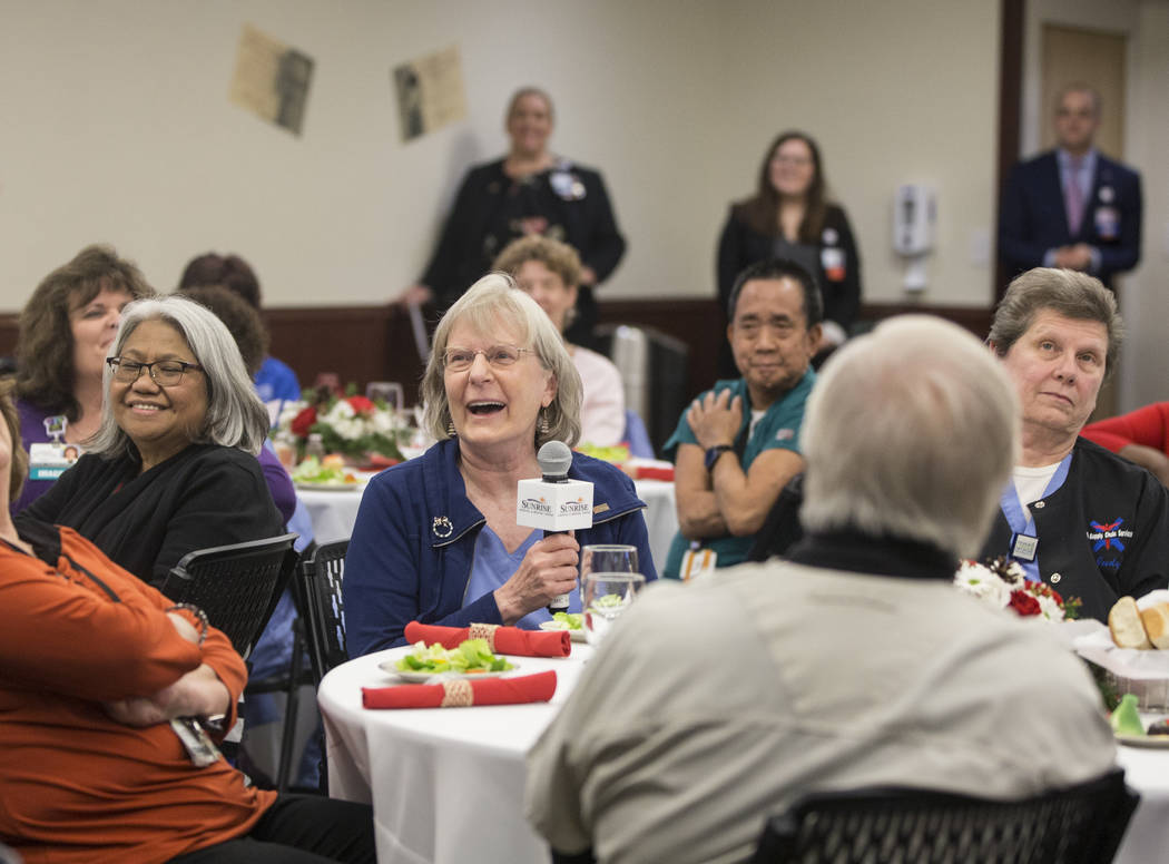 Mary McElhattan, middle, shares a laugh with attendees during a 60th anniversary luncheon for Sunrise Hospital and Medical Center on Wednesday, Dec. 12, 2018, in Las Vegas. Benjamin Hager Las Vega ...
