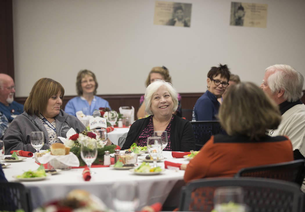 Leslie Mower, middle, shares a laugh with attendees during a 60th anniversary luncheon for Sunrise Hospital and Medical Center on Wednesday, Dec. 12, 2018, in Las Vegas. Benjamin Hager Las Vegas R ...