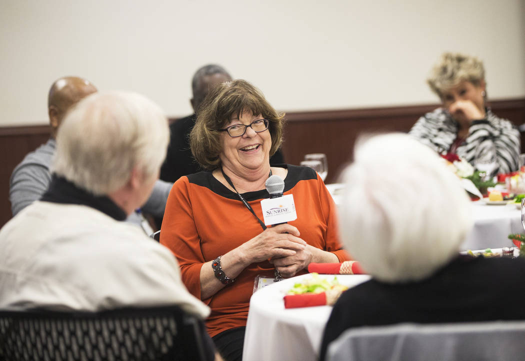 Marie Hokanson, middle, introduces herself during a 60th anniversary luncheon for Sunrise Hospital and Medical Center on Wednesday, Dec. 12, 2018, in Las Vegas. Benjamin Hager Las Vegas Review-Journal