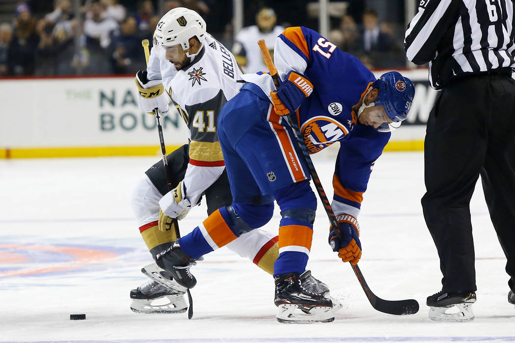 Vegas Golden Knights center Pierre-Edouard Bellemare (41) and New York Islanders center Valtteri Filppula (51) battle for the puck after a face off during the first period of an NHL hockey game, W ...