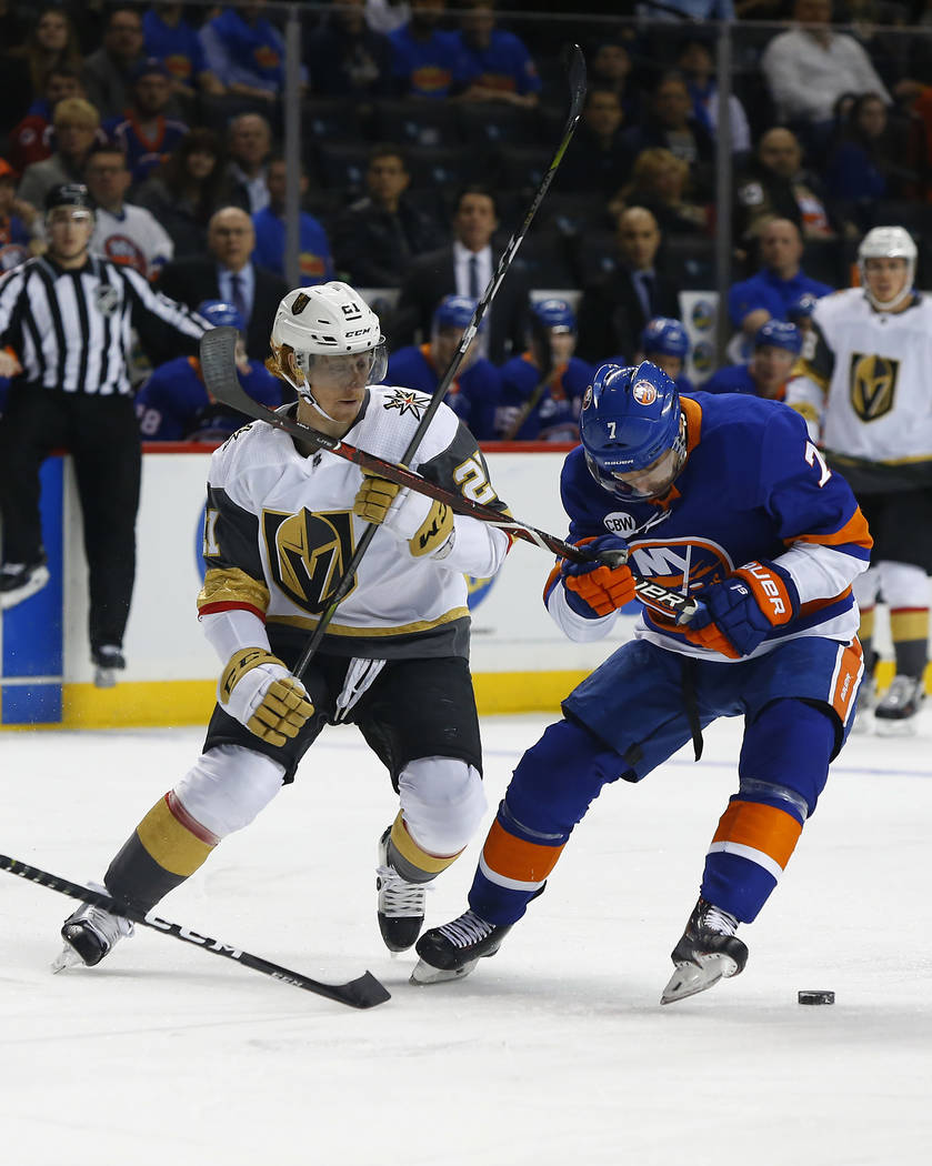 Vegas Golden Knights center Cody Eakin (21) and New York Islanders right wing Jordan Eberle (7) battle for the puck during the first period of an NHL hockey game, Wednesday, Dec.12, 2018, in New Y ...