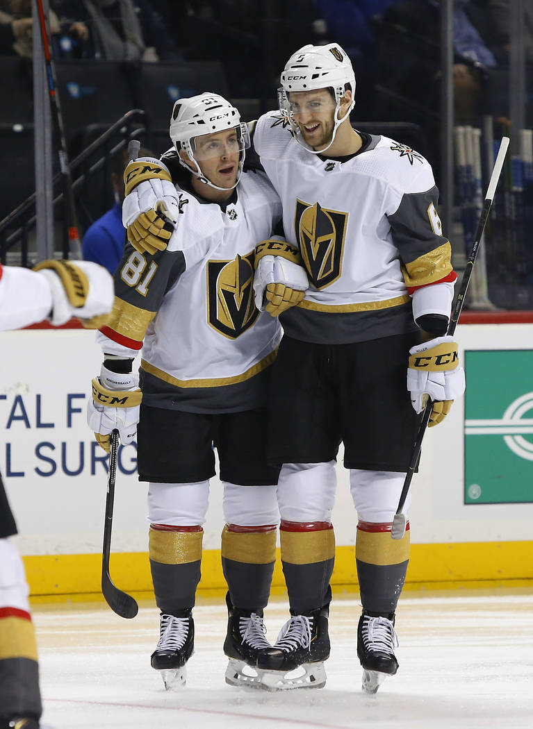 Vegas Golden Knights' Jonathan Marchessault (81) celebrates with defenseman Colin Miller (6) after scoring a goal against the New York Islanders during the first period of an NHL hockey game, Wedn ...