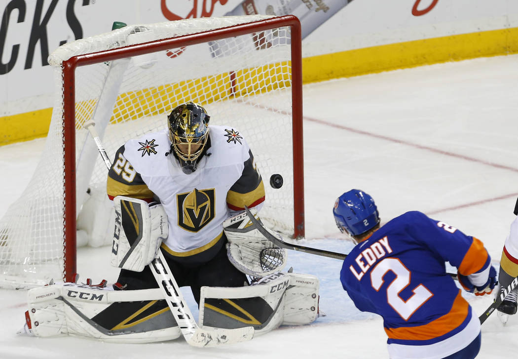 Vegas Golden Knights goaltender Marc-Andre Fleury (29) stops a shot at goal by New York Islanders defenseman Nick Leddy (2) during the third period of an NHL hockey game, Wednesday, Dec. 12, 2018, ...