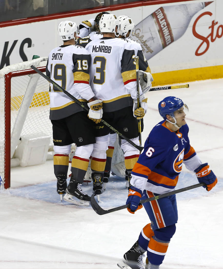 New York Islanders defenseman Ryan Pulock (6) reacts as the Vegas Golden Knights celebrate defeating the New York Islanders after an NHL hockey game, Wednesday, Dec. 12, 2018, in New York (AP Phot ...