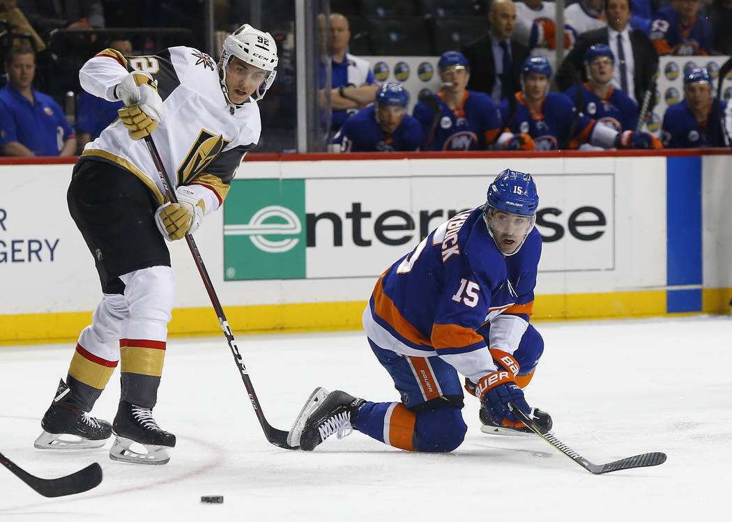 New York Islanders right wing Cal Clutterbuck (15) plays the puck against Vegas Golden Knights left wing Tomas Nosek during the second period of an NHL hockey game, Wednesday, Dec.12, 2018, in New ...