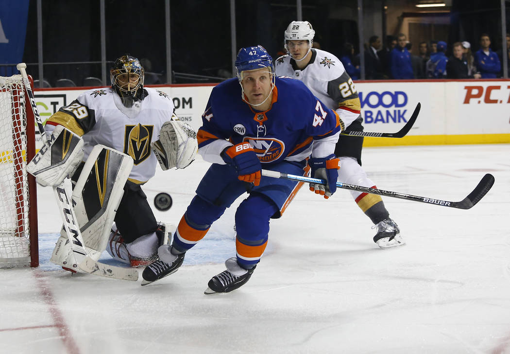 New York Islanders right wing Leo Komarov (47) plays the puck against Vegas Golden Knights goaltender Marc-Andre Fleury (29) and Vegas Golden Knights defenseman Nick Holden (22) during the second ...