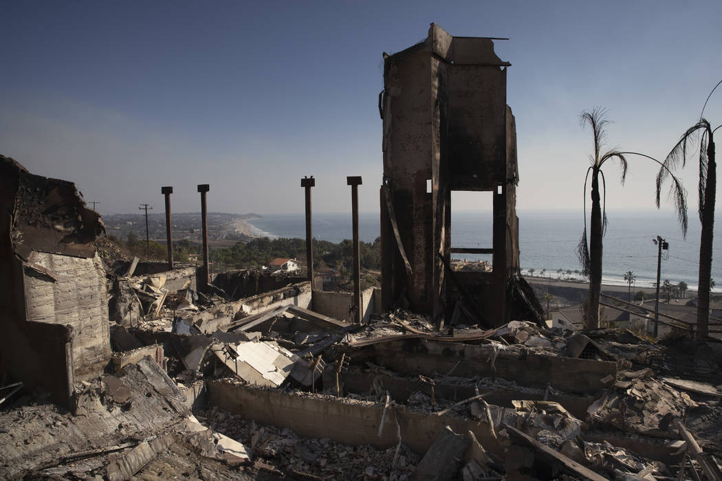 A home burned down by a wildfire sits on a hilltop overlooking the Pacific Ocean in Malibu, Calif. on Nov. 11, 2018. Authorities estimate it will cost at least $3 billion to clear debris of 19,000 ...