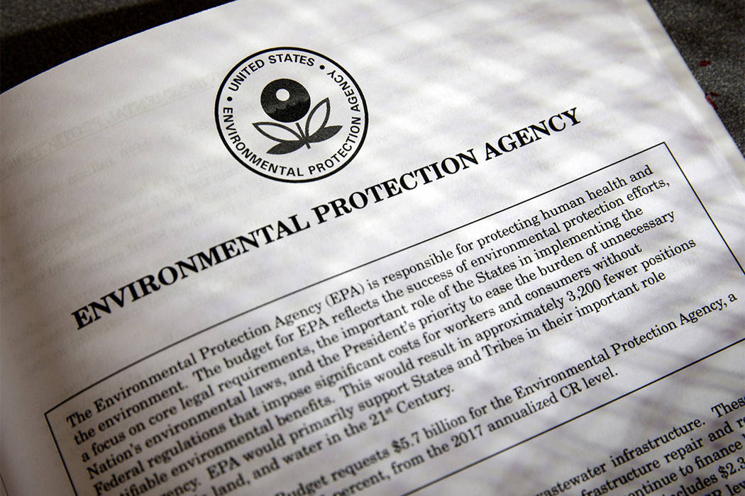 In this March 16, 2017, file photo, proposals for the Environmental Protection Agency in President Donald Trump's first budget are displayed at the Government Printing Office in Washington. (J. Sc ...