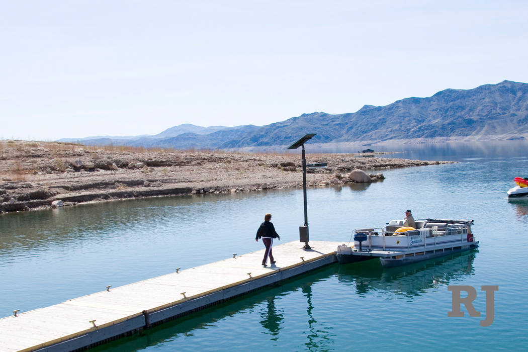 The dock at South Cove boat launch ramp, near the eastern end of Lake Mead National Recreation Area, as it looked in September 2007, when the lake level was about 30 feet higher than it is now. (N ...