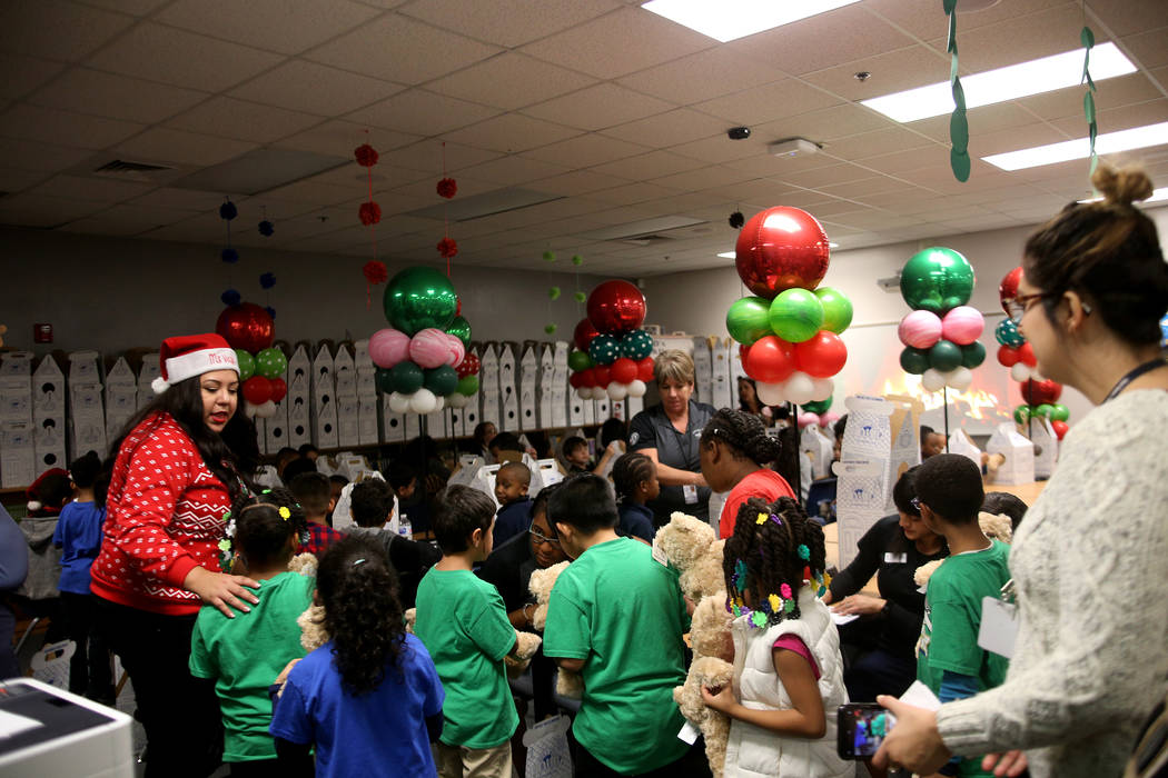 Student line up to get the birth certificates for their stuffed bear at the Build-A-Bear-Workshop at Doris Reed Elementary School in Las Vegas, Thursday, Dec. 13, 2018. Rachel Aston Las Vegas Revi ...
