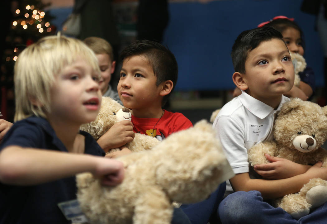 Nathan Manore, 6, from left, Alesky Rubio Roa, 6, and wait with their stuffed bears at the Build-A-Bear-Workshop at Doris Reed Elementary School in Las Vegas, Thursday, Dec. 13, 2018. Rachel Aston ...