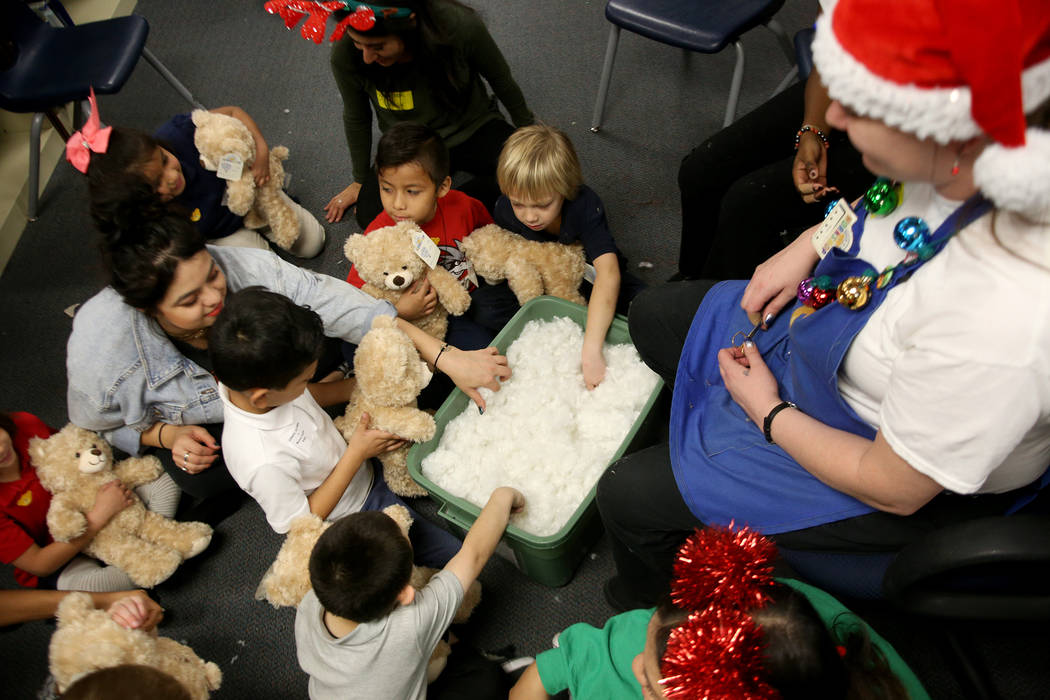 Students grab stuffing for their bear at the Build-A-Bear-Workshop at Doris Reed Elementary School in Las Vegas, Thursday, Dec. 13, 2018. Rachel Aston Las Vegas Review-Journal @rookie__rae