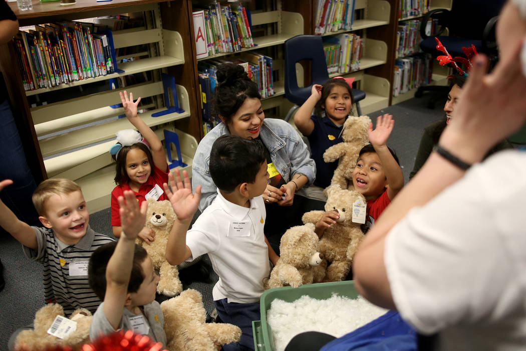 Students grab vow to take care of their stuffed bears at the Build-A-Bear-Workshop at Doris Reed Elementary School in Las Vegas, Thursday, Dec. 13, 2018. Rachel Aston Las Vegas Review-Journal @roo ...