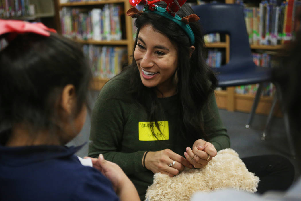 Karen Avila helps Lisbeth Ramon San Pedro, 7, sew up her stuffed bear at the Build-A-Bear-Workshop at Doris Reed Elementary School in Las Vegas, Thursday, Dec. 13, 2018. Rachel Aston Las Vegas Rev ...