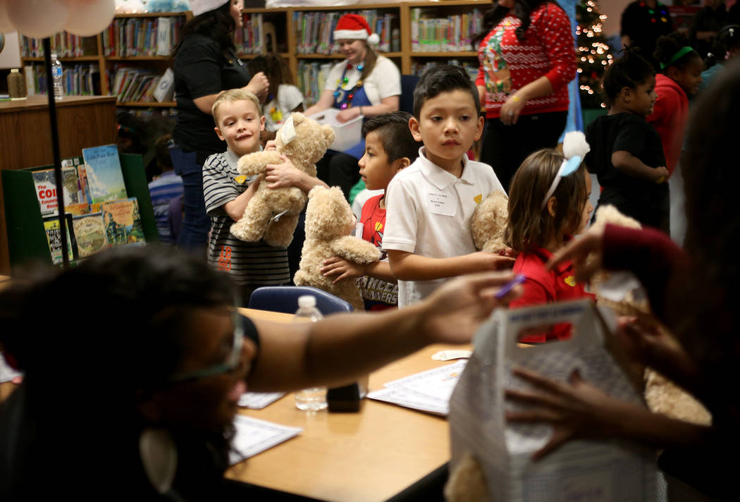 Student line up to get the brith certificates for their stuffed bear at the Build-A-Bear-Workshop at Doris Reed Elementary School in Las Vegas, Thursday, Dec. 13, 2018. Rachel Aston Las Vegas Revi ...