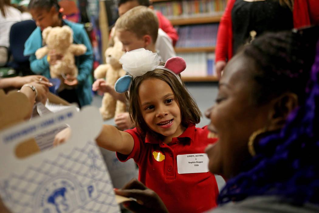 Sophia Hopper, 6, receives assistance with her bear's birth certificate at the Build-A-Bear-Workshop at Doris Reed Elementary School in Las Vegas, Thursday, Dec. 13, 2018. Rachel Aston Las Vegas R ...
