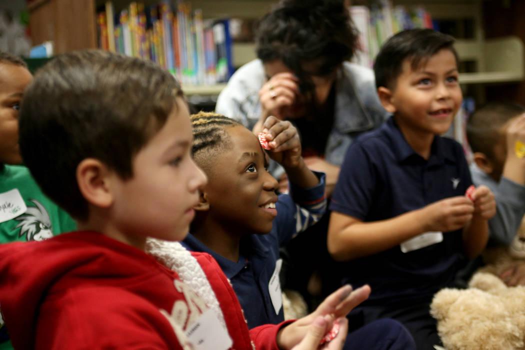 Gabriel Dibwe holds a stuffed heart to his head at the Build-A-Bear-Workshop at Doris Reed Elementary School in Las Vegas, Thursday, Dec. 13, 2018. Rachel Aston Las Vegas Review-Journal @rookie__rae