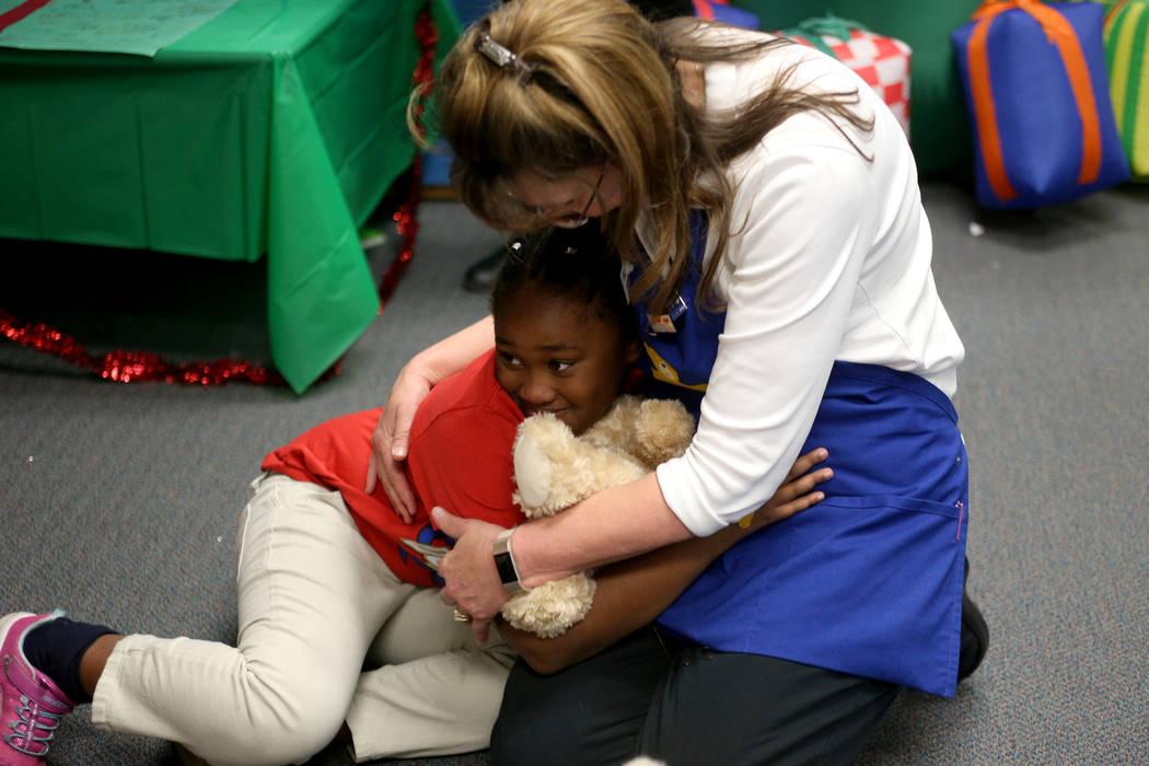 Ahmari Braxton-Shelby, 10, hugs Julie Hayes, the district manager for Build-A-Bear, at the Build-A-Bear-Workshop at Doris Reed Elementary School in Las Vegas, Thursday, Dec. 13, 2018. Rachel Aston ...