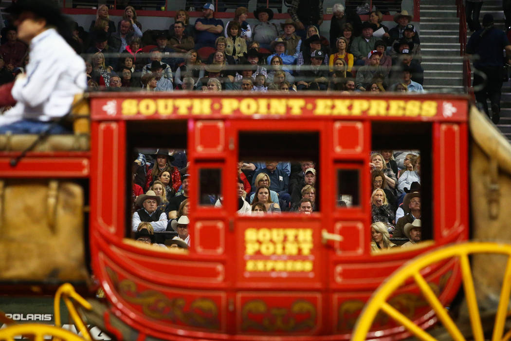 A South Point Express carriage makes its way through the arena as fans watch during the sixth go-round of the National Finals Rodeo at the Thomas & Mack Center in Las Vegas, Tuesday, Dec. 11, ...