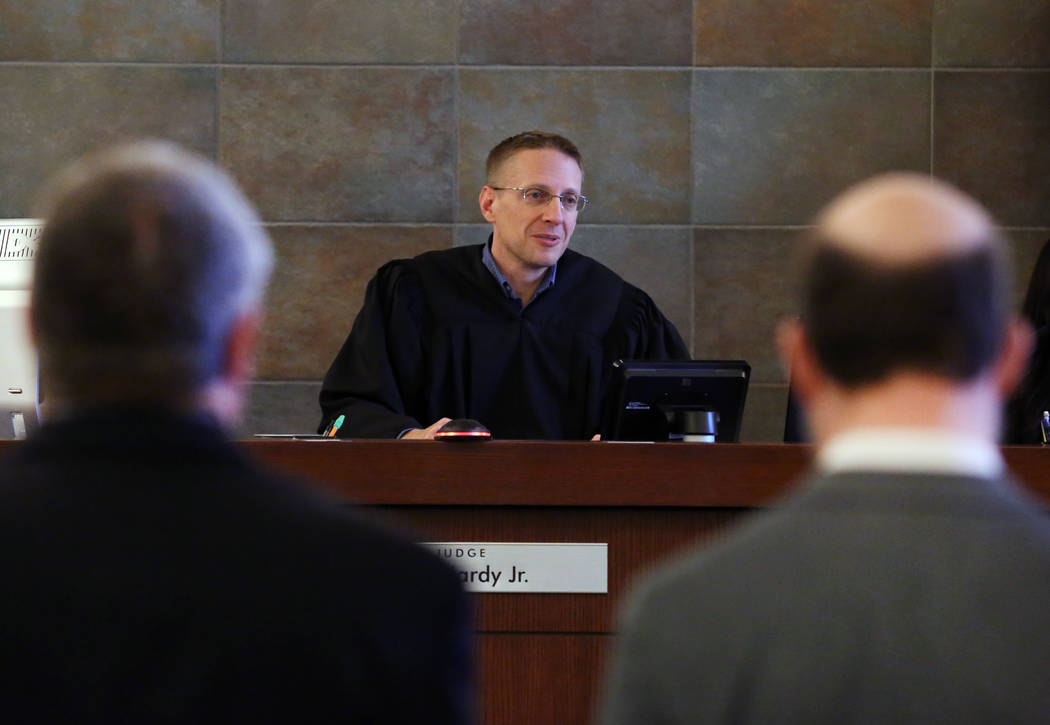 Henderson Constable Earl Mitchell, left, and his attorney David Figler listen as Judge Joe Hardy Jr., center, presides during Mitchell's first court appearance at the Regional Justice Center on Th ...