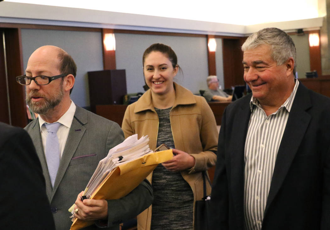 Henderson Constable Earl Mitchell, right, leaves the courtroom with his attorneys, David Figler, left, and Alanna Bondy, after his first court appearance at the Regional Justice Center on Thursday ...