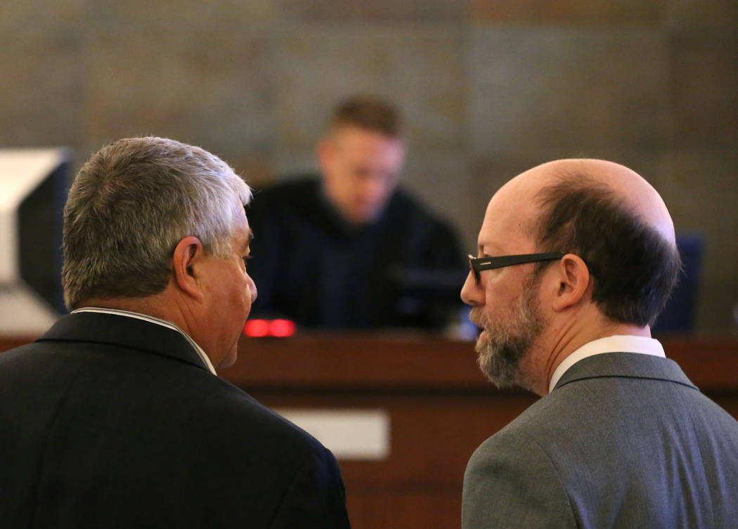 Henderson Constable Earl Mitchell, left, consults with his attorney David Figler as Judge Joe Hardy Jr., center, presides during his first court appearance at the Regional Justice Center on Thursd ...