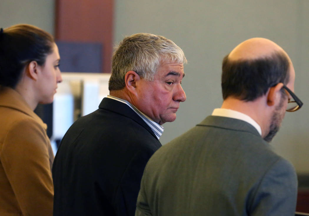 Henderson Constable Earl Mitchell, center, appears in court with his attorneys Alanna Bondy, left, and David Figler, during his first court appearance at the Regional Justice Center on Thursday, D ...