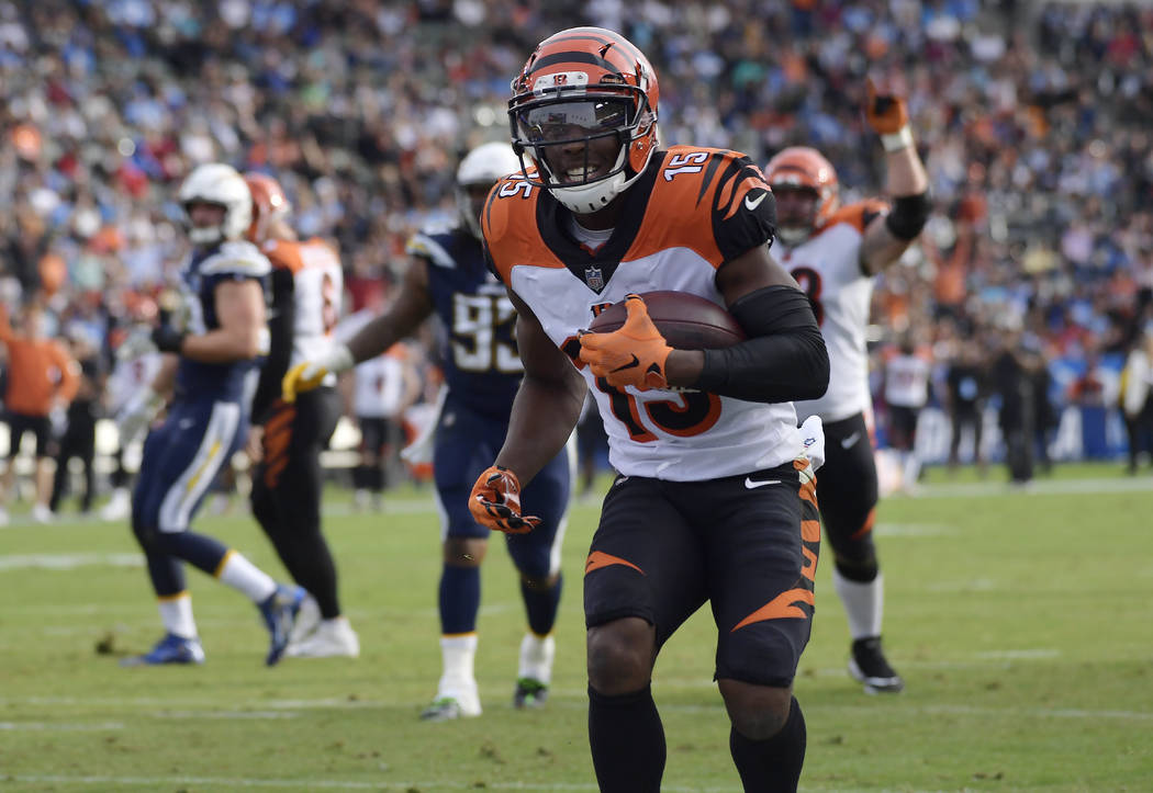 Cincinnati Bengals wide receiver John Ross (15) scores a touchdown against the Los Angeles Chargers during the first half of an NFL football game Sunday, Dec. 9, 2018, in Carson, Calif. (AP Photo/ ...