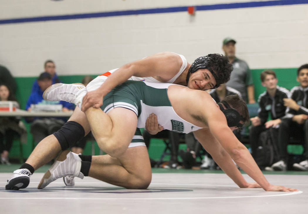 Valley's John Baloyot, top, wrestles Green Valley's Mitch Jacobs during their 220lb. match on Thursday, Nov. 29, 2018, at Green Valley High School, in Henderson. Benjamin Hager Las Vegas Review-Jo ...