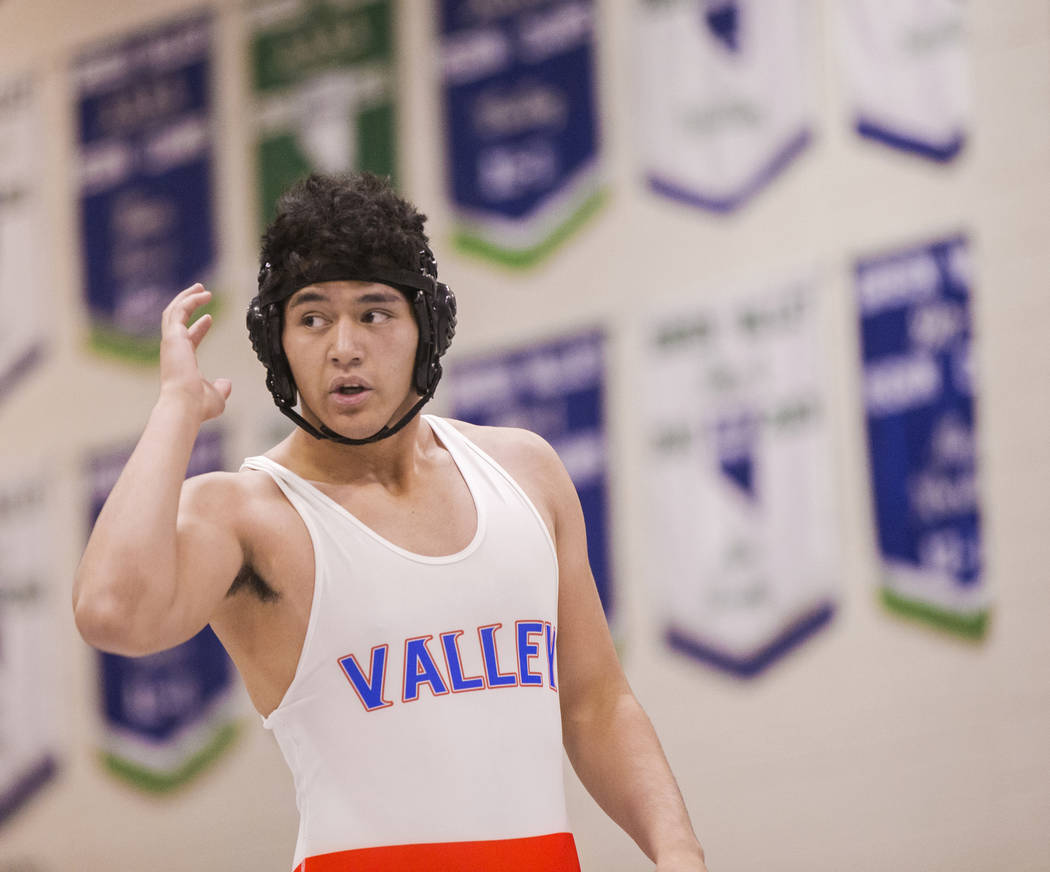 Valley's John Baloyot gets some quick direction from his coach during his 220lb. match on Thursday, Nov. 29, 2018, at Green Valley High School, in Henderson. Benjamin Hager Las Vegas Review-Journal