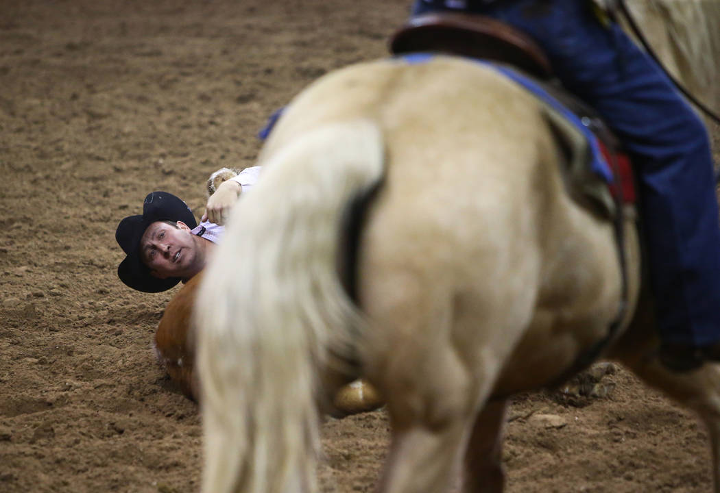 Riley Duvall of Checotah, Okla. (92) competes in steer wrestling during the seventh go-round of the National Finals Rodeo at the Thomas & Mack Center in Las Vegas, Wednesday, Dec. 12, 2018. Ca ...