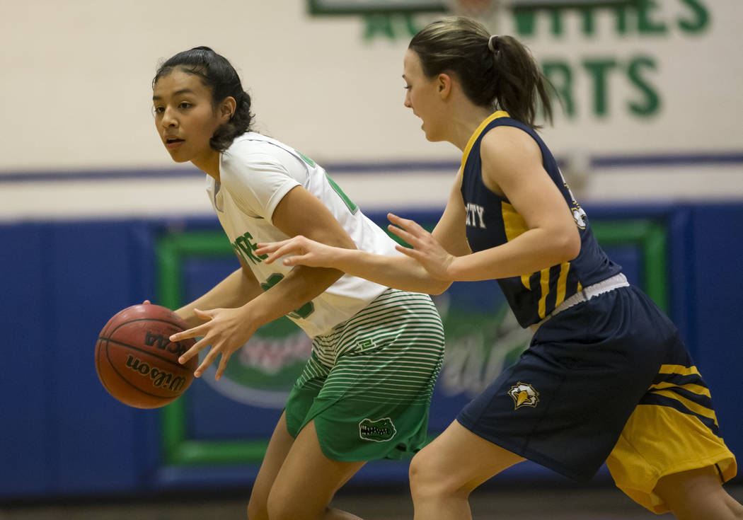 Green Valley's Michelle Lagunas-Monroy (20) drives the ball against Boulder City guard Hannah Estes (35) during the first half of a varsity basketball game at Green Valley High School in Henderson ...