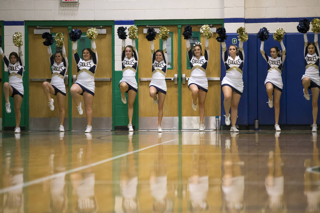 Green Valley cheerleaders hype the crowd during the second half of a varsity basketball game between Green Valley and Boulder City at Green Valley High School in Henderson on Wednesday, Dec. 12, 2 ...
