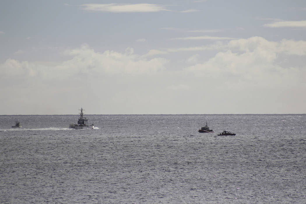 A U.S. Coast Guard vessel and other rescue boats respond to a plane crash off Honolulu, Wednesday, Dec. 12, 2018. Federal Aviation Administration spokesman Ian Gregor said a Hawker Hunter jet went ...