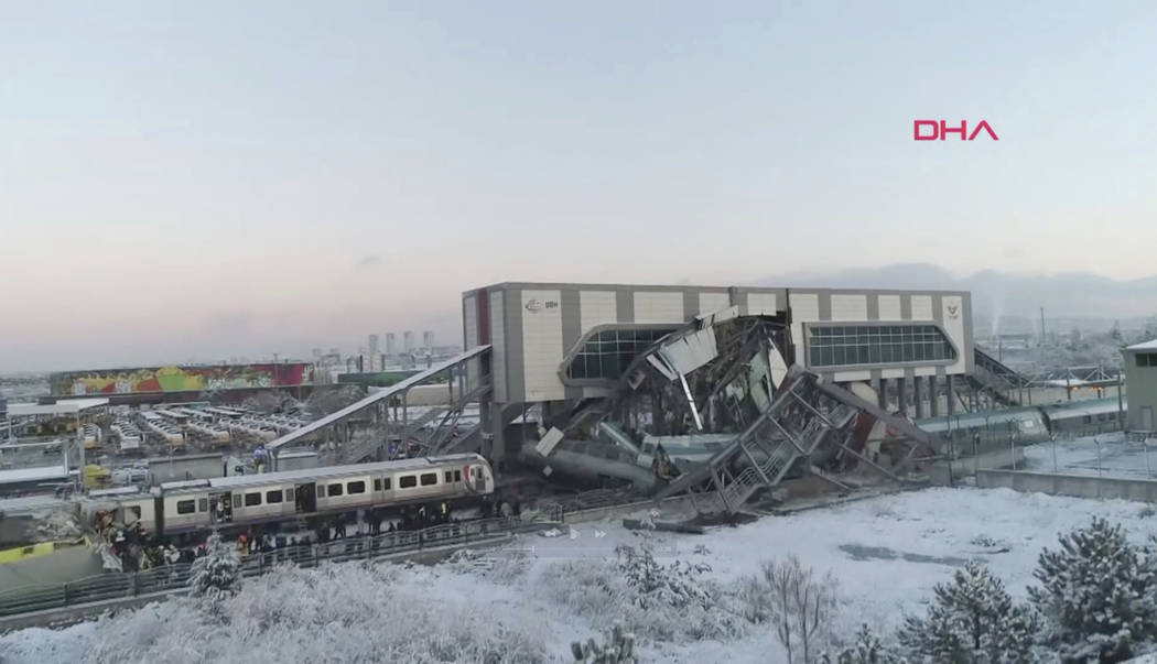 This image made from video shows aftermath of a high-speed train crash at a station in Ankara, Turkey, Thursday, Dec. 13, 2018. The train hit a railway engine and crashed into a pedestrian overpas ...