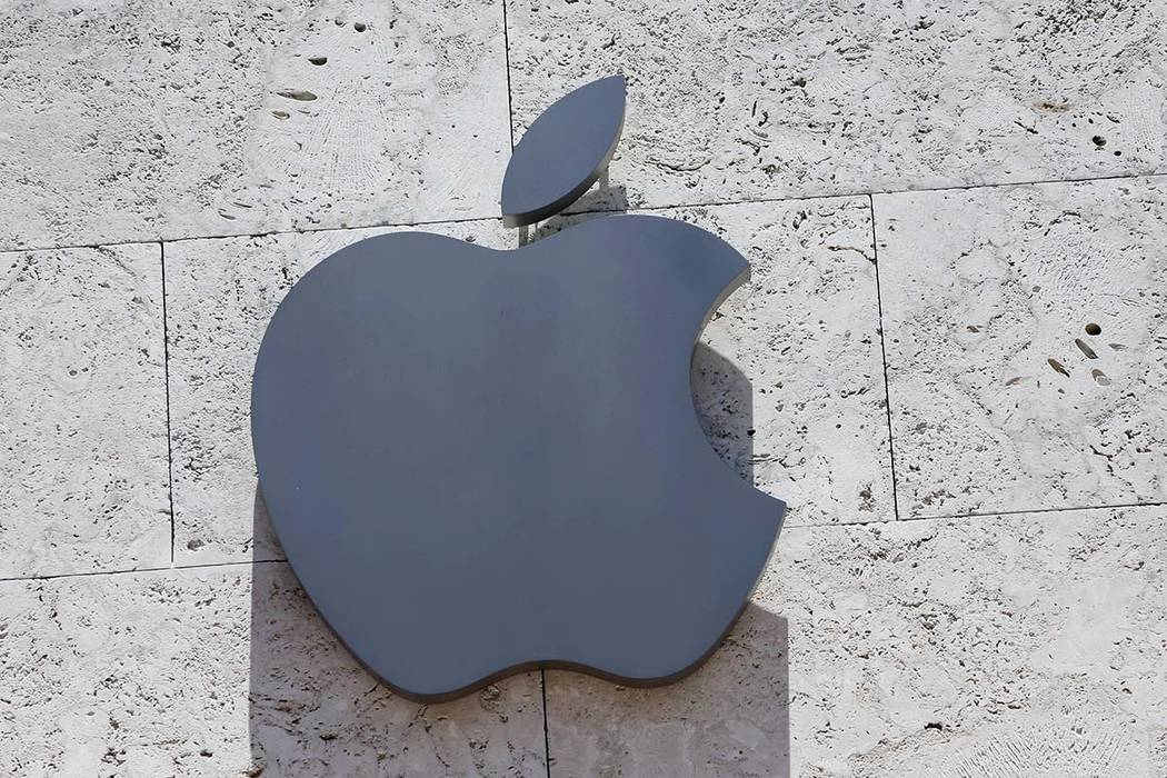 In this Aug. 8, 2017, file photo, the Apple logo is shown at a store in Miami Beach, Fla. Apple released a statement early Thursday, Dec. 13, 2018, saying it plans to build a $1 billion campus in ...