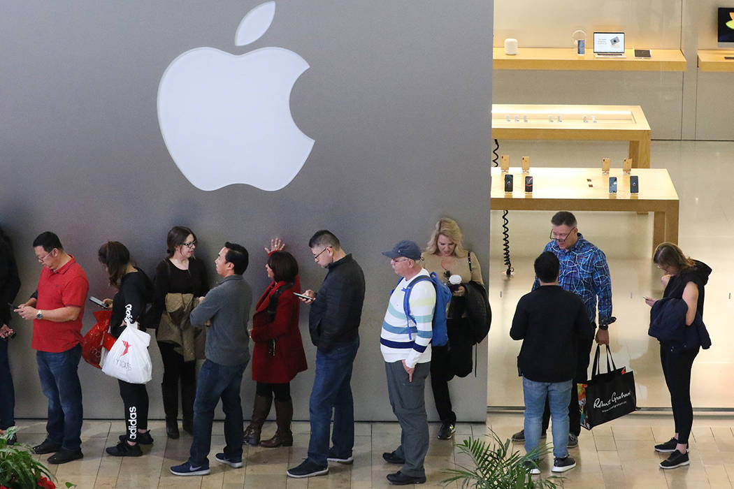 Black Friday sale shoppers stand in line at the Fashion Show Mall Apple Store on Friday, Nov. 23, 2018. Apple says it plans to build a $1 billion campus in Austin, Texas. Bizuayehu Tesfaye Las Veg ...