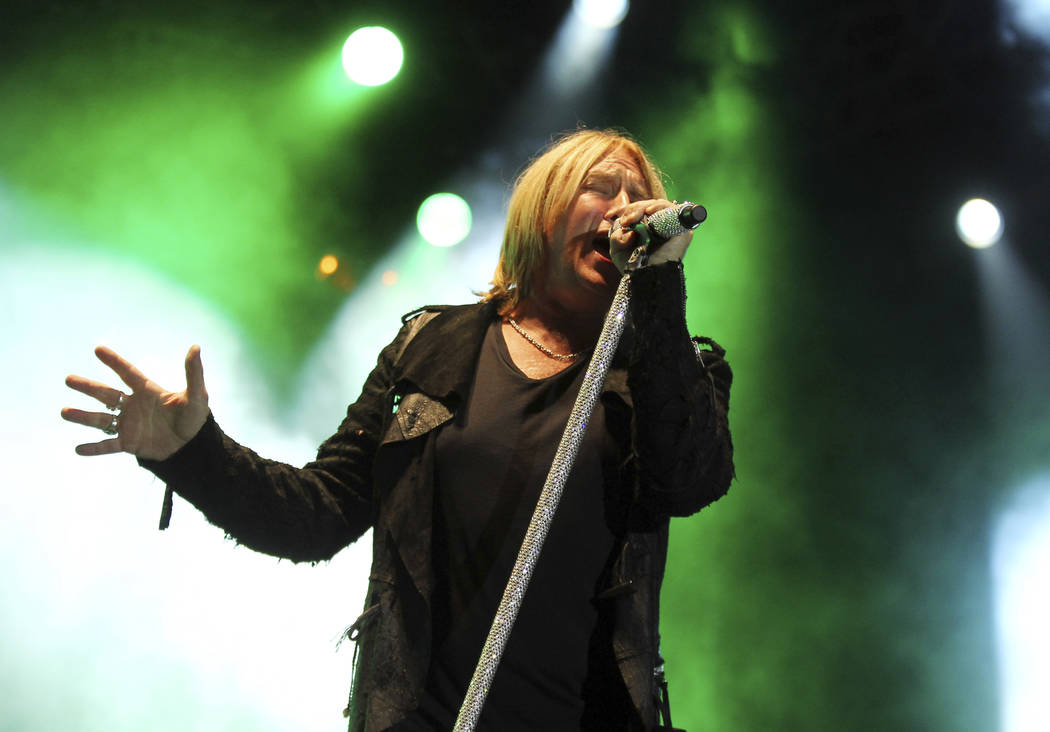 """This June 8, 2012 file photo shows Joe Elliott performing with the band Def Leppard at the after party for the """"Rock of Ages"""" premiere in Los Angeles. Def Leppard will join Janet Jackson, Stevie N ..."""