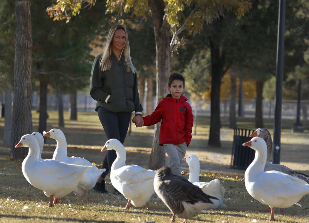 Liam Benyamine, 6, walks with his mother, Dominika, both of Henderson, at Sunset Park on Thursday, Dec. 13, 2018, in Las Vegas. Bizuayehu Tesfaye Las Vegas Review-Journal @bizutesfaye