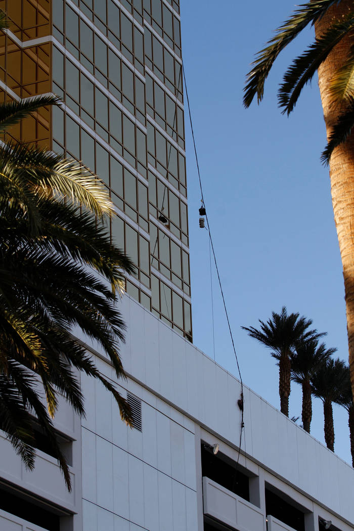A wire from Trump International hotel is seen in Las Vegas, Wednesday, Dec. 12, 2018. A man washing windows outside the hotel fell to his death Wednesday afternoon. (Chitose Suzuki/Las Vegas Revie ...